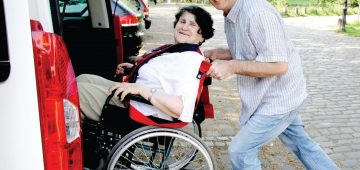 9451713 - young man assisting senior woman in wheelchair